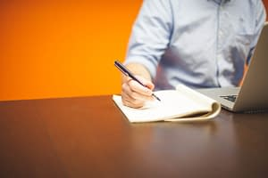 man-writing-desk