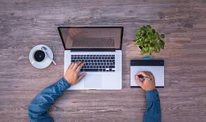desk-coffee-laptop-plant-man