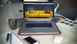 laptop-on-desk-displaying-a-settee